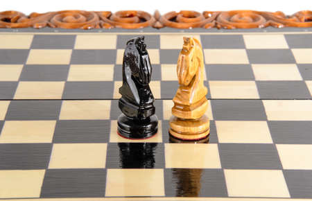 �chessboard: wooden chessboard handmade. woodcarving. game of chess