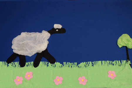 Lamb of cloth in a meadow
