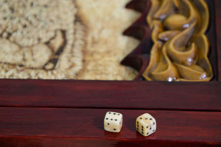 playing dice on a game board