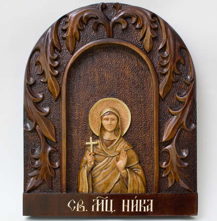 Carved icon from wood handmade. Holy Nicka Stock Photo