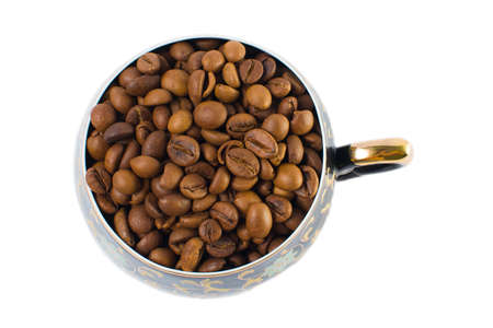 Coffee beans in a small cup on a white background. Isolated