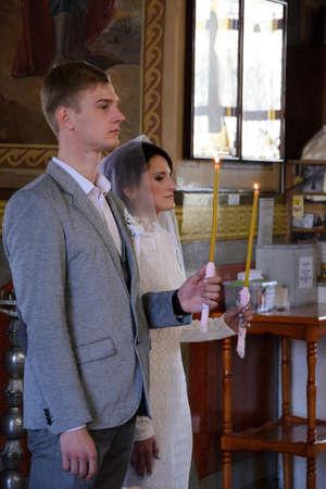 Alchevsk, Ukraine - April 28, 2017: Wedding ceremony of newlyweds in the Christian church