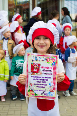Alchevsk, Ukraine - September 24, 2017: school cooks for children in a cafe and awarding the best chefs