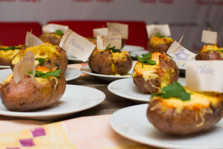 children learn how to cook stuffed potatoes in class