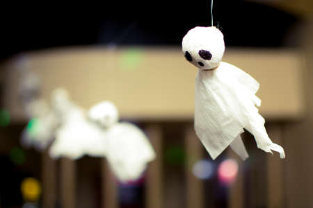 a small ghost of paper hanging on a rope 版權商用圖片