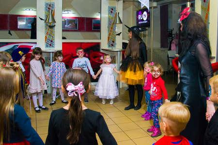 Alchevsk, Ukraine - October 24, 2018: children play with animators in halloween costumes.