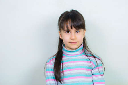 portrait of a child. Nice girl with long hair.