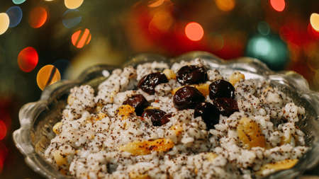 Kutya made from whole grains of rice, barley, rarely millet or rice with the addition of honey or sugar. Traditional Slavic festive Christmas dish in Ukraine, Belarus and Russia. Bokeh background