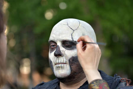 refreshes: NOVOSIBIRSK, RUSSIA - JUNE 4, 2016: Master refreshes make-up actor, participating in youth festival Editorial