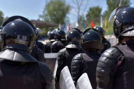 sanctioned: Fighters of the special police units armed with special facilities for mass action