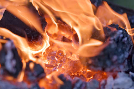 smolder: Flames and glowing embers in the hearth of a blacksmith