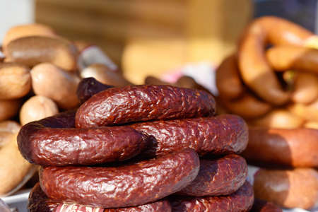 larder: Smoked sausage is homemade on the trade counter close-up