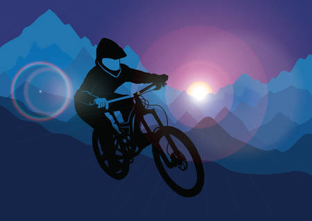 descending: Silhouette of a racer descending on a bicycle on a mountainside against the background of the evening sun