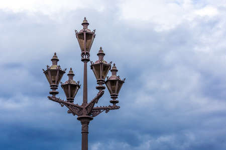 Street lamp in the background of rain clouds