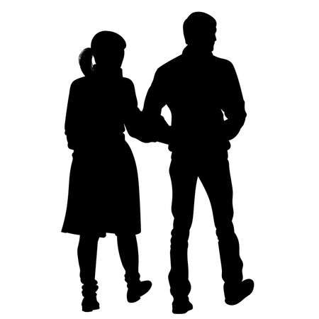 Silhouette of a girl and a young man walking alongside hand in hand.