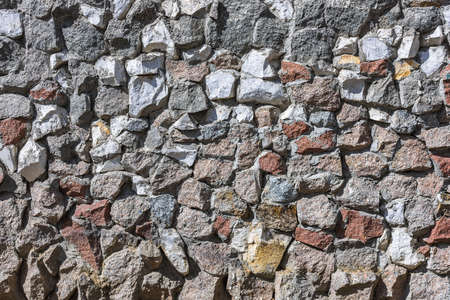 Texture of wall lined with varied natural stone for background decoration 版權商用圖片