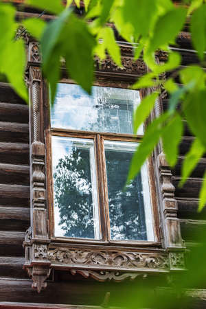 Wooden window with carved platbands of a traditional Siberian house 版權商用圖片