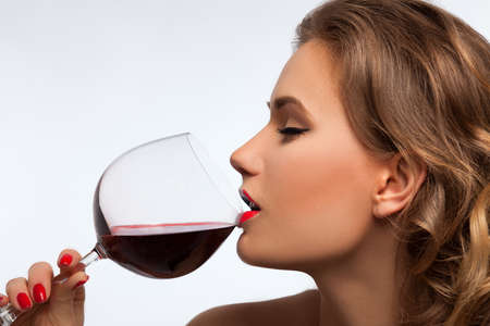 blond girl with glass of wine photo