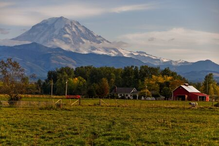 Tranquil,serene farm scene with Mount Rainier Stock Photo