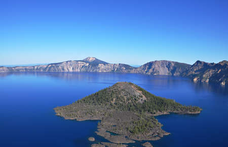 A view of Wizard Island from the western rim of Crator Lake. Stock Photo