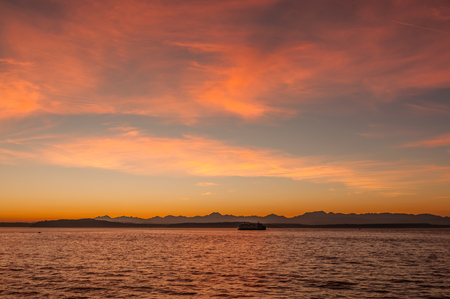 Beautiful indian summer sunset captured  from west Seattle looking over Elliot Bay Stock Photo
