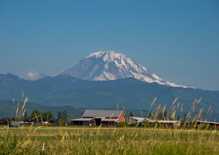 Farm the the Enumclaw valley,with view of Mt. Rainier.