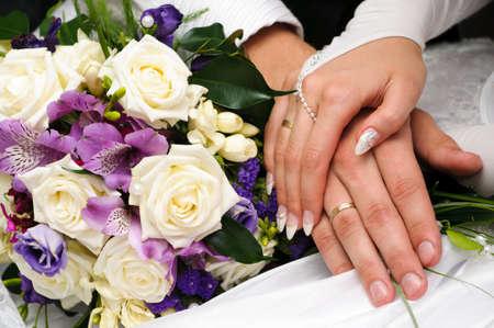 hands in hand of wedding couple Stock Photo - 8550602