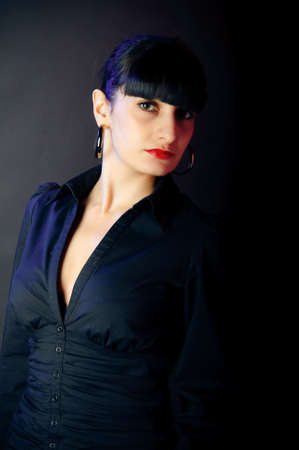 armenian woman: brunette portrait. red and blue lighted is not photoshop. Its natural light from colored lamp. Stock Photo