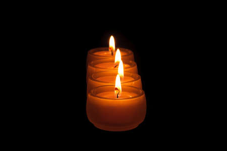 Beautiful candles burning on a black background