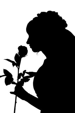 Silhouette of woman in wedding dress with rose photo