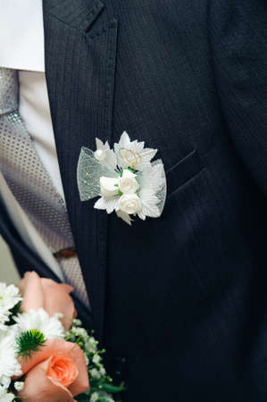 buttonhole: posy with roses on groom suit. wedding decorate suit