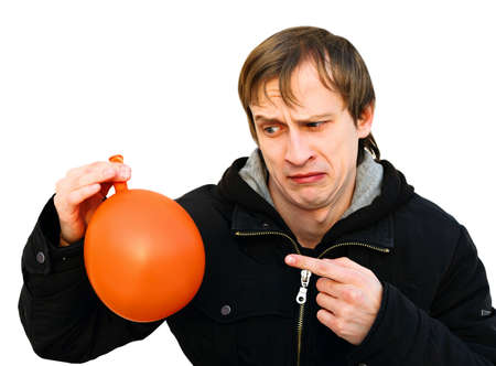 dissatisfied young man hold a balloon and noticed that it is blow off  dissatisfied face  pay attention to smb