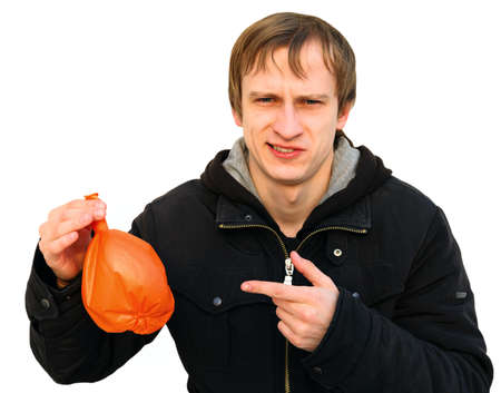 young man speaks about unfortunate business showing it on an example of the blown-off balloon