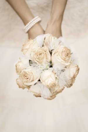 beauty wedding bouquet of roses in a bride hands  retro style