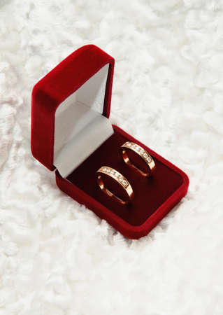 two gold diamond rings in open box  Love symbol Stock Photo - 17562313