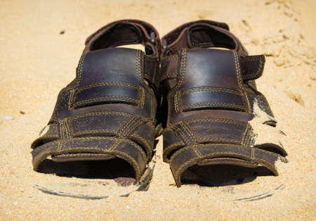 two sandals to sprinkle with sand. Heat summer background Stock Photo