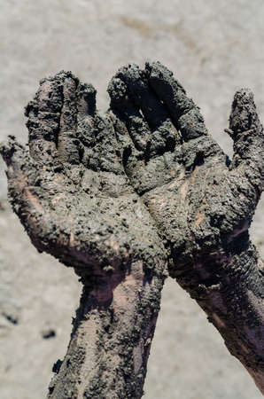soiled: take a mud cure. healthy medical procedure. dirty hands