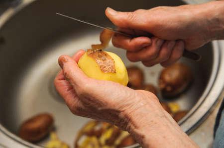 Elderly woman to peel potatoes  Kitchen working  Prepare food