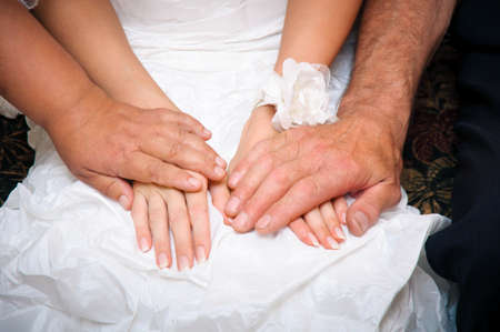 affecting: parents blessing and supporting for bride in a wedding dress