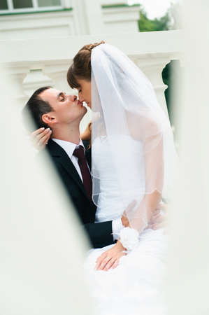 groom embracing bride and kiss nose  Love couple photo