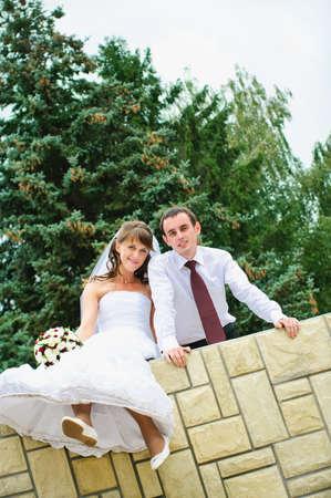 dangle: wedding couple looking and dangle feet. Tenderness loving