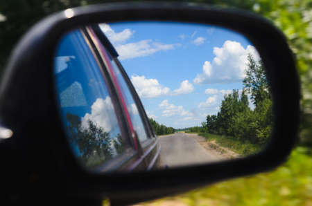 advance travelling on rural roads. car riding. rear-view mirror photo