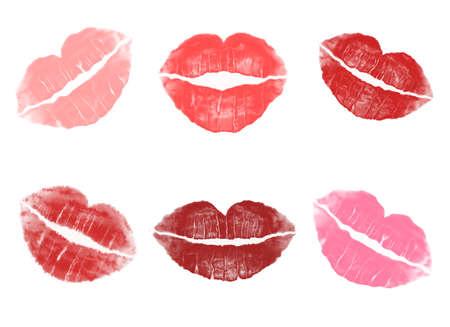 白い背景にさまざまな赤い口紅インプリント背景 写真素材