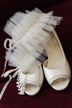 two white bride weddings easy shoes on a dark background photo