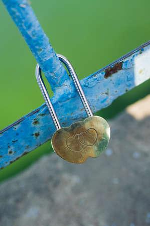 engraving hearts of padlock. Wedding tradition photo