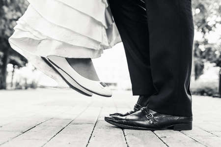 wedding shoes in a standing bride and groom. retro vintage photo photo