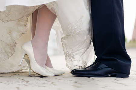 wedding shoes of bride and groom. face to face standing