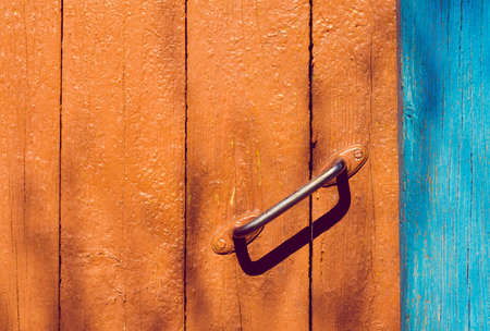 symbol of poverty  old handle of wooden door   photo