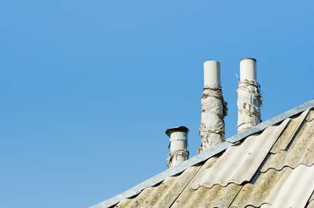 three chimney on diagonal roof  abstract photo photo