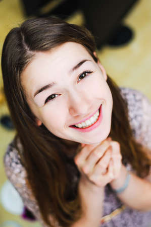intercede: face of cheerful smile positive young woman